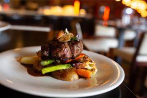 MANZO: Hanger Steak, Allnatural Black Angus Beef, Seasonal Local Vegetables, Rosemary Roasted Potatoes. Photography By Jamie Robbins.