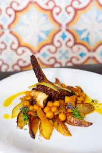 POLPO: Mediterranean Octopus, Chick Peas, Tomato Confit, Roasted Garlic, Chili, Fresh Parsley. Photography By Jamie Robbins.