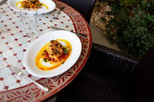 POLPO: Mediterranean Octopus, Chick Peas, Tomato Confit, Roasted Garlic, Chili, Fresh Parsley. Photography By Jamie Robbins.