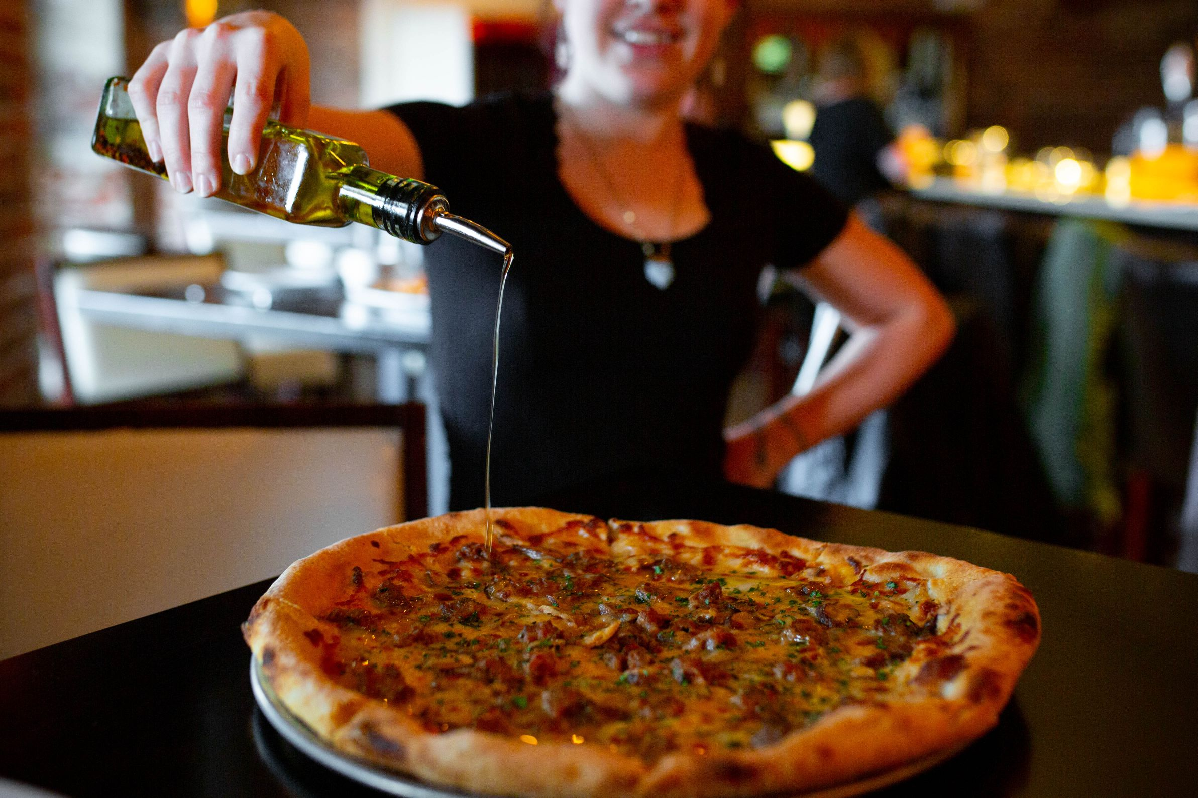 Pizza at Mulino Italian Kitchen & Bar. Photography By Jamie Robbins.